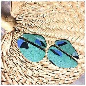 Mint and periwinkle geometric statement earrings